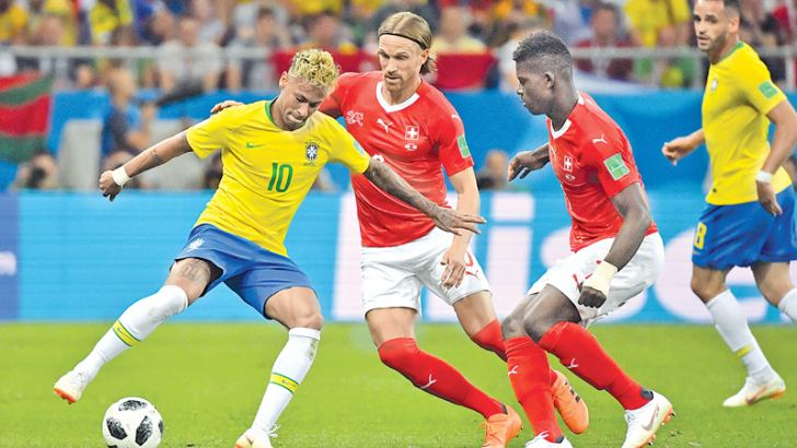Brazil's forward Neymar (L) controls the ball during the Russia 2018 World Cup Group E football match against Switzerland at the Rostov Arena in Rostov-On-Don on Sunday. - AFP