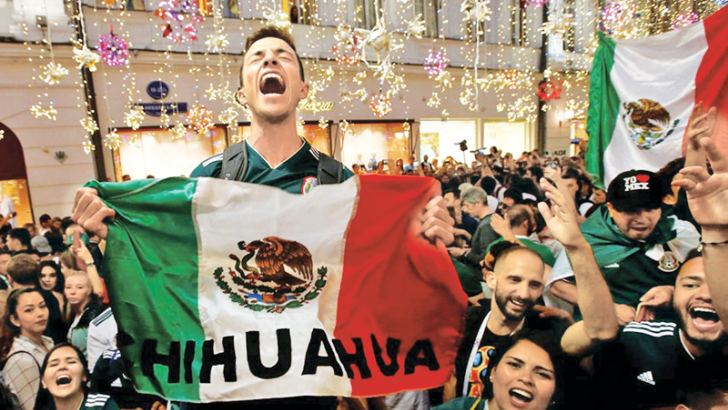 Mexico's fans celebrate victory of their team after the match against Germany