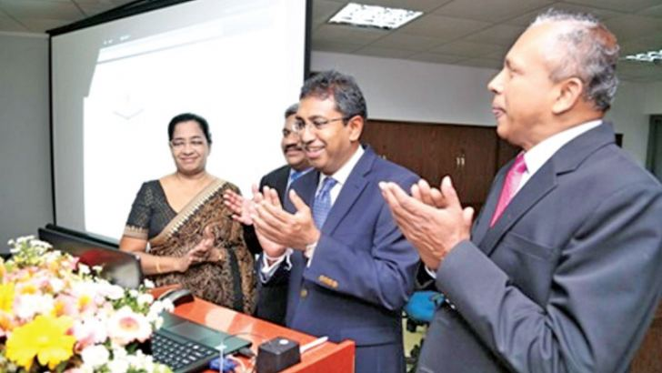 Digital repository and the online library catalogue of the DCS being launched by State Minister of National Policies and Economic Affairs, Dr. Harsha De Silva.