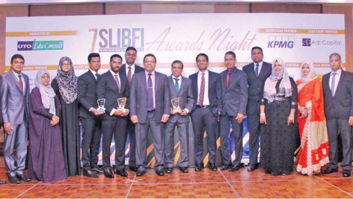 HNB Managing Director / CEO Jonathan Alles, Deputy General Manager, Corporate Banking, Ruwan Manatunga, Assistant General Manager, Islamic Banking Hisham Ally, Head of Project Finance, Majella Rodrigo with the staff of Islamic banking unit at the award ceremony