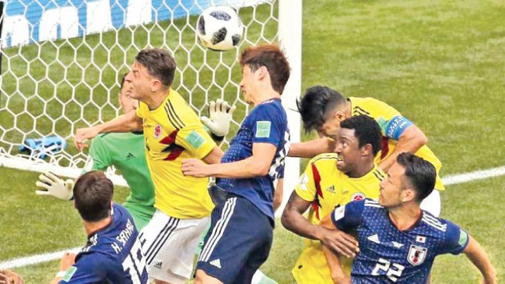 Japan's Yuya Osako scores their second goal against Colombia.