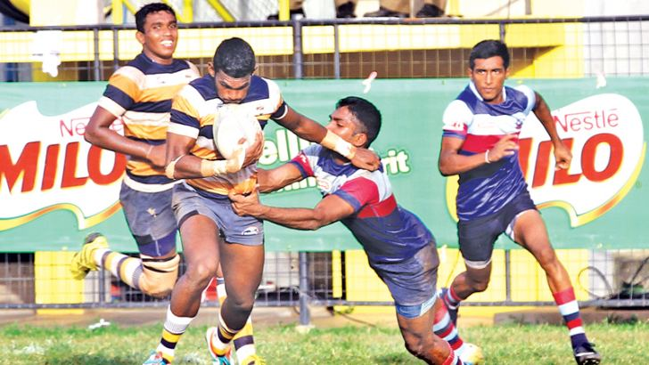 Peterite hero Dilshan Madusanka (with ball in hand) trying to evade a Anthonian defender.  Picture by Shan Rambukwella