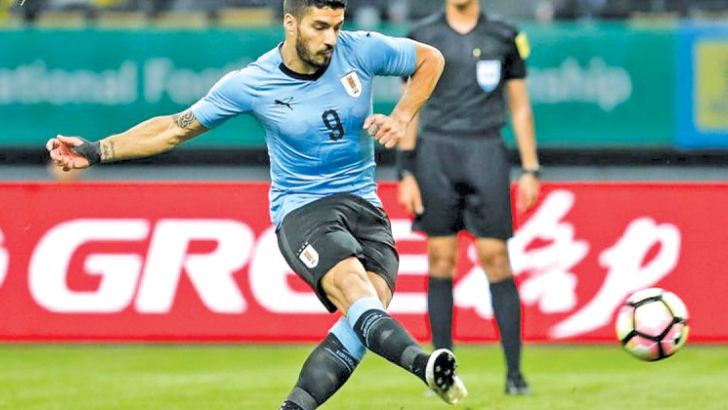 Luiz Suarez will make his 100th appearance for Uruguay v Saudi Arabia on Wednesday