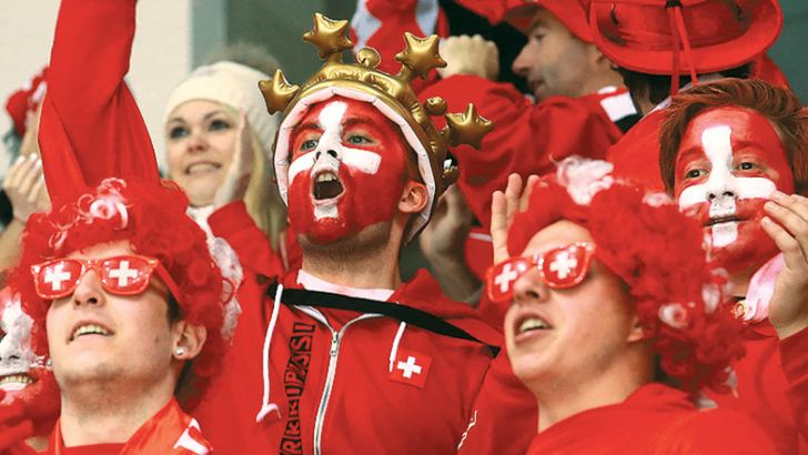 Swiss fans cheer for their side against Brazil