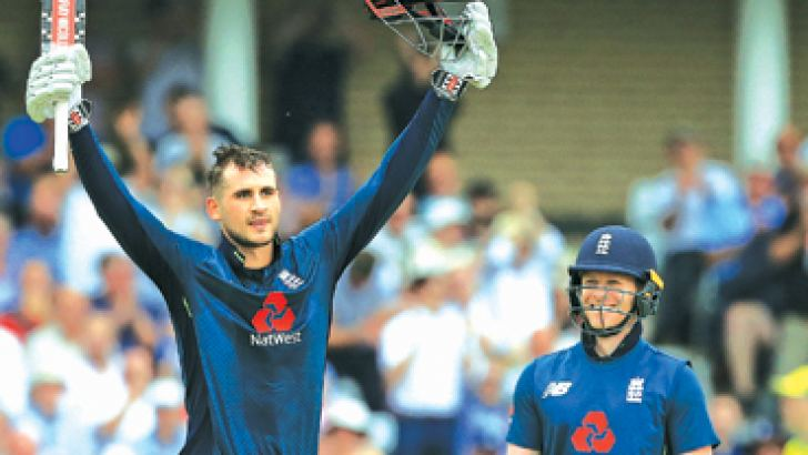 Man of the Match England's Alex Hales (L) celebrates his century as Eoin Morgan looks on during the third One-Day International (ODI) against Australia at Trent Bridge, Nottingham on Tuesday. - AFP