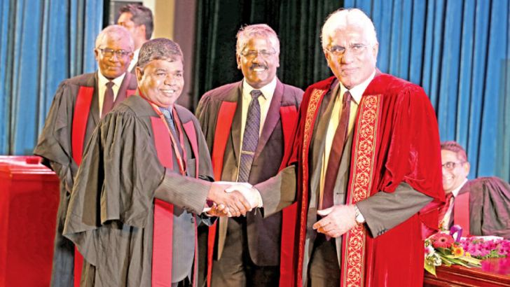CBSL Governor Dr. Indrajit Coomaraswamy awarding the Honorary Fellowship to D.M.Gunasekara, former General Manager/CEO, Bank of Ceylon. IBSL Chairman K.D.Ranasinghe and IBSL Director General P. J. Jayasinghe were present