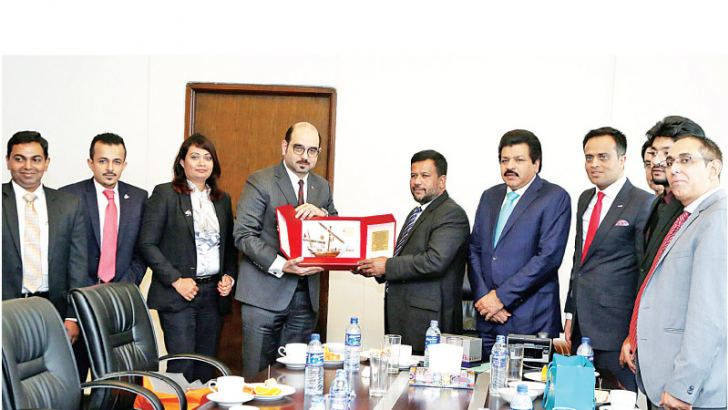 Bahraini business delegation led by Managing Director of Manama's Al  Jaberiya Group Mohammed Sajid (sixth from left) hand over a souvenir to  Minister  Bathiudeen