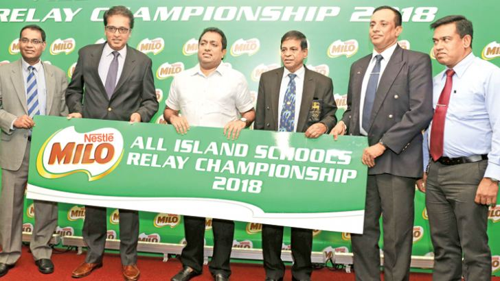 Vice Presidents Nestle Lanka Ltd. Bandula Egodage and Norman Kannangara handing over the Sponsorship to Minister of Education for the All Island Schools Relay Championship at the press briefing held in Colombo on Tuesday. Also in the picture are Sunil Jayaweera Senior Consultant Sport, Col. Manjula Kariyawasam Director Physical Training Ministry of Education and Deputy Director Athula Wijewardene.
