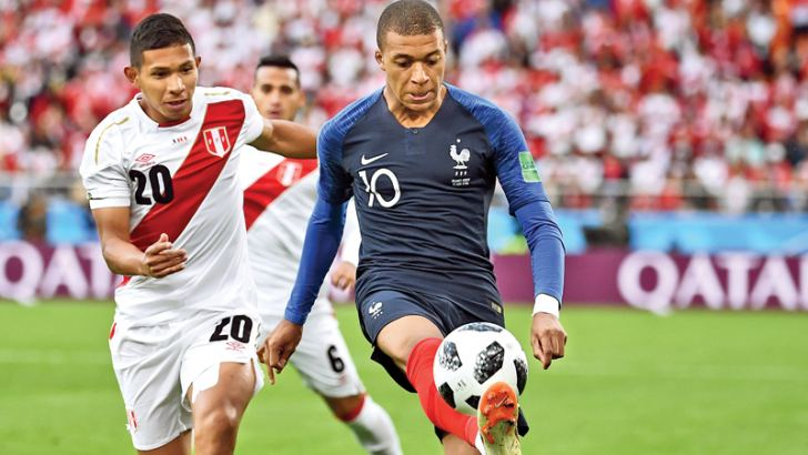 France's forward Kylian Mbappe (C) controls the ball next to Peru's midfielder Edison Flores (L) during the Russia 2018 World Cup Group C football match between France and Peru at the Ekaterinburg Arena in Ekaterinburg on June 21. AFP