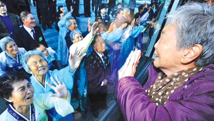 South Koreans in a bus bid farewell to their North Korean relatives – separated for 60 years following the Korean War – before they return to their home after a family reunion in this November 5, 2010 picture  in Mount Kumgang, North Korea.