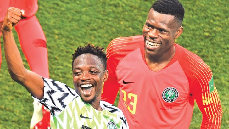Nigeria's forward Ahmed Musa (L) and Nigeria's goalkeeper Francis Uzoho celebrate at the end of the Russia 2018 World Cup Group D football match between Nigeria and Iceland at the Volgograd Arena in Volgograd on June 22, 2018.  AFP