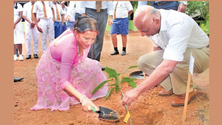 Assetline Leasing Company Limited Director Ananda Seneviratne planting a tree celebrating its 15th anniversary