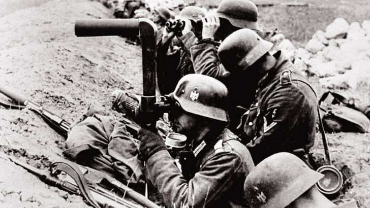 German infantrymen watch enemy movements from their trenches shortly before an advance inside Soviet territory in 1941.
