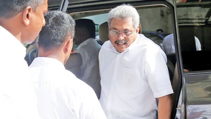Former Defence Secretary Gotabhaya Rajapaksa arriving at the FCID yesterday.  Picture by Rukmal Gamage