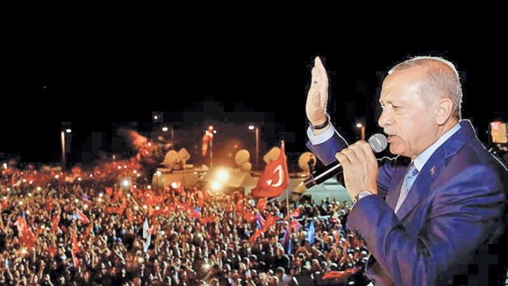 Turkish President Recep Tayyip Erdogan waves to supporters after his re-election in Istanbul.