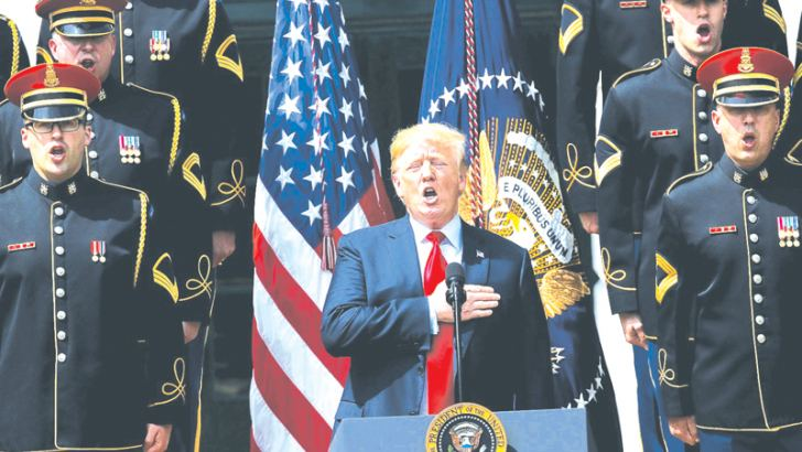 "Donald Trump sings the national anthem with a U.S. Army chorus during a ""Celebration of America"" event on the south lawn of the White House June 5, 2018 in Washington, DC."