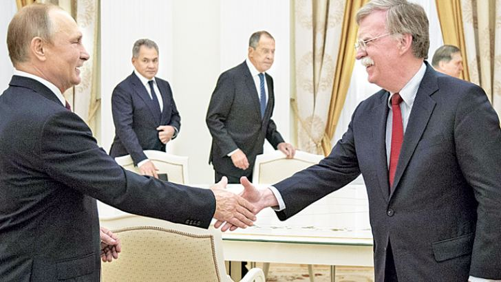 Russian President Vladimir Putin shakes hands with US National Security Adviser John Bolton during their meeting in the Kremlin in Moscow on Wednesday. - AFP