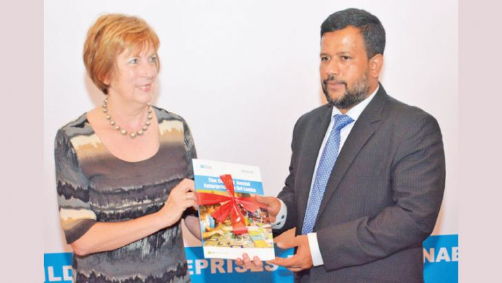 British Council Country Director, Gill Caldicott presenting a copy of the report on the 'State of Social Enterprises in Sri Lanka', to Minister of Industry and Commerce Rishad Bathiudeen. Picture by Sarath  Pieris
