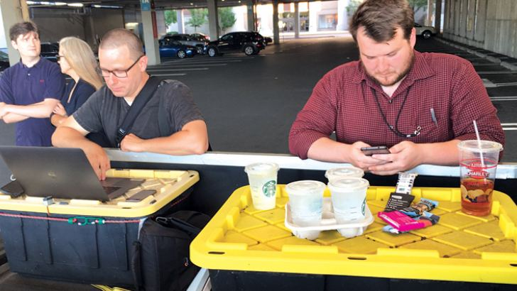 Capital Gazette reporter Chase Cook (R) and photographer Joshua McKerrow (L) work on the next day's newspaper while awaiting news from their colleagues in Annapolis, Maryland on Thursday. At least five people were killed Thursday when a gunman opened fire inside the offices of the Capital Gazette, a newspaper published in Annapolis, a historic city an hour east of Washington. Jarrod Ramos of Laurel Md. has been arrested and charged with the killings. - AFP