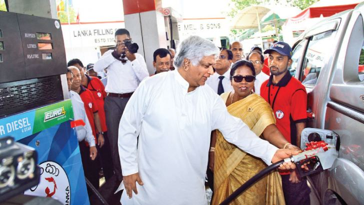 Minister of Petroleum Resource Development Arjuna Ranatunga and Deputy Minister of Petroleum Resource Development Anoma Gamage at the introduction of Euro spec fuel dispenser at C.F. De Mel and Sons Filling Station in Colombo. Picture by Shan Rambukwella