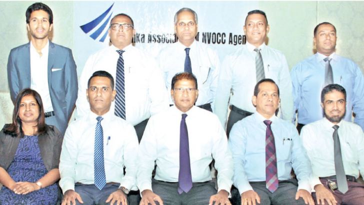 Executive committee for 2018 /19: Swabha Wickramasinghe, Minnaz Riyal, Secretary SLANA, Capt. A V Rajendra, Chairman SLANA, Prasad Jinadasa, Vice Chairman SLANA, Mohamed Thahir, Treasurer SLANA. Standing L-R: Ananda Senanayake, Perma Shipping, Tharanga Perera, Clarion Shipping,  Nalin Abeysekara, Pan Oceanic International, Raj Rasiah, Smart Marine Lanka, Harsha De Silva, McLarens Logistics at the event. Pictures by Saliya Rupasinghe