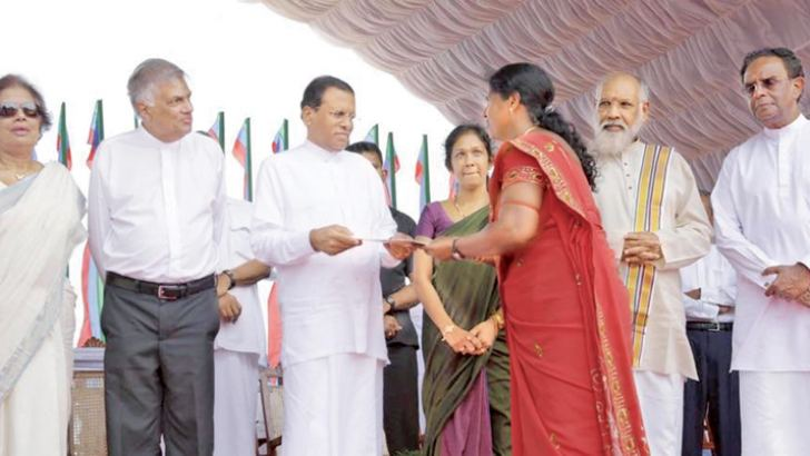Title deeds handed over to recipients by President Maithripala Sirisena in March 2015.