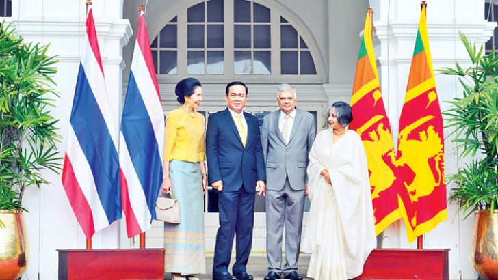 Thai Prime Minister Prayut Chan-o-cha called on Prime Minister Ranil Wickremesinghe at Temple Trees  yesterday. Associate Professor Naraporn Chan-o-cha and Prof. Maithri Wickramasinghe look on. Picture by Hirantha Gunathilake.