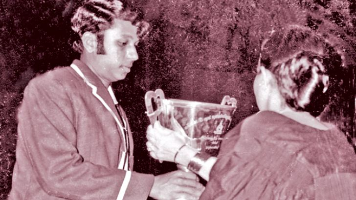 Daya Sirisena receiving the Best All Round Cricketer award at the 1970 College Prize Giving from the then Prime Minister of Ceylon Mrs. Sirimavo Bandaranaike.