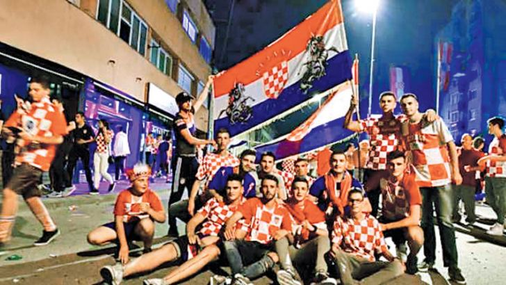 Bosnian Croats in Livno, the home town of coach Zlatko Dalic, support their team in the semi-final against England.