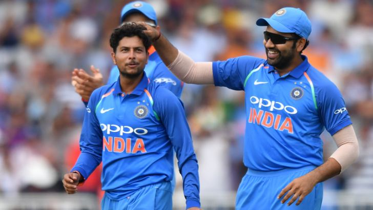 India's Kuldeep Yadav (L) celebrates after finishing his spell, taking his sixth wicket, that of England's David Willey during the first One Day International at Trent Bridge, Nottingham on Thursday.  - AFP