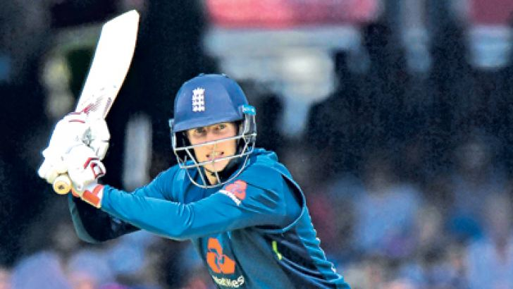 England's Joe Root plays a shot and makes his century during the second One Day International (ODI) cricket match against India, at Lord's Cricket  Ground on Saturday. - AFP.