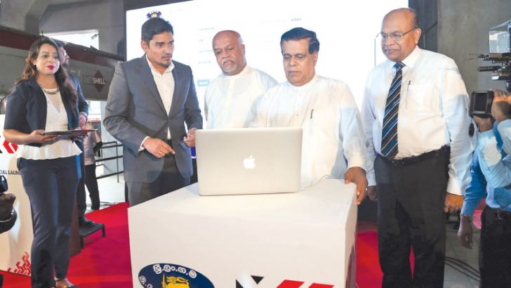 Minister Nimal Siripala de Silva launches the SLTB Express app at a ceremony at the Pettah Central Bus Station.
