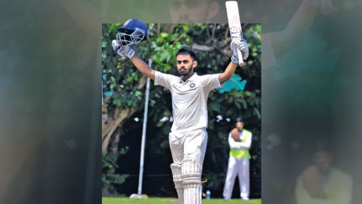 Indian opener Atharwa Taiden celebrates his century on the second day of the first four-day under 19 cricket test against Sri Lanka at the NCC grounds yesterday. Pic by Susantha Wijegunasekera
