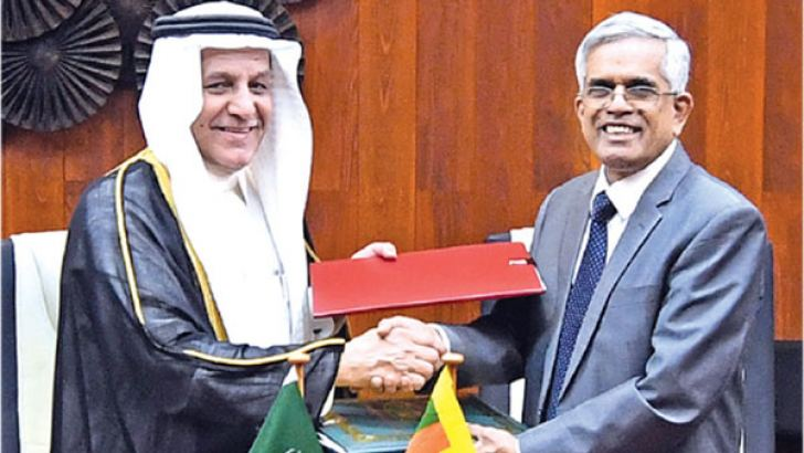 Dr. R.H.S. Samaratunge, Secretary to the Ministry of Finance exchanging the agreement with Eng. Yousef Ibrahim Al Abdulrahman Al Bassam, Vice Chairman and Managing Director, Saudi Fund