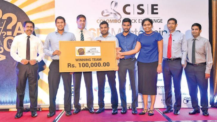 CSE Director, Dilshan Wirasekara presenting Lanka Securities the winning prize, accompanied by CSE CRO, Renuke Wijayawardhane, CSE CIO, Chandrakanth Jayasinghe and CSE Head of Market Development, Niroshan Wijesundere