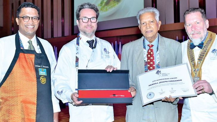Dilmah Founder Merrill J Fernando receiving the Lifetime Achievement Award from WorldChefs President Thomas Gugler (Extreme right) Also in the picture, Dilhan C Fernando - CEO Dilmah Tea, Ragnar Fridriksson - Managing Director at World Association of Chefs Societies