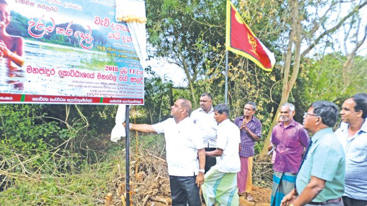 Minister Mahinda Amaraweera launching the development project.