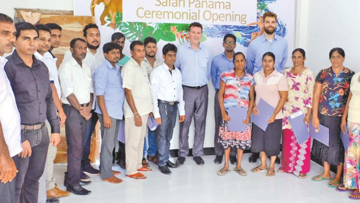 Australian High Commissioner Bryce Hutchesson,  MDF Country Director Shahroz Jalil and Safari Panama owner Priyantha Pushpakumara with his staff and the homestay owners, at the opening.