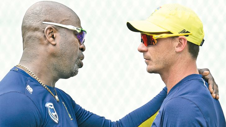 South African fast bowler Dale Steyn (right) speaks with coach Ottis Gibson during a training session at the SSC grounds yesterday. Steyn requires one more wicket to become his country's leading Test wicket taker. – AFP