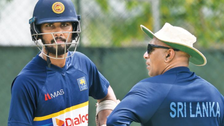 Suspended captain Dinesh Chandimal and coach Chandika Hathurusingha were both at the SSC nets yesterday helping the Sri Lanka team prepare for the second Test against South Africa. – AFP