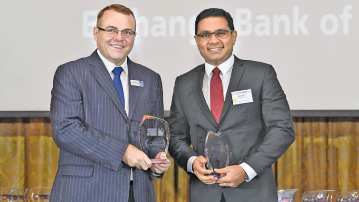 Commercial Bank's Chief Operating Officer designate, Sanath Manatunge accepting the awards won by the Bank at the 2018 Asian Banking & Finance awards
