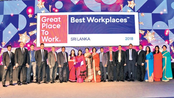 "The McLarens Team receiving the Great Place to Work Award at the Hilton Colombo. ""This unbelievable journey of ours wouldn't have been possible without our loyal employees; therefore we extend our appreciation and thank all our employees for sticking with us through thick and thin."""