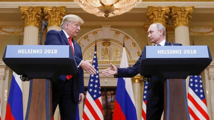 US President Donald Trump and Russian President Vladimir Putin during a joint news conference after their meeting in Helsinki on Monday. - AFP