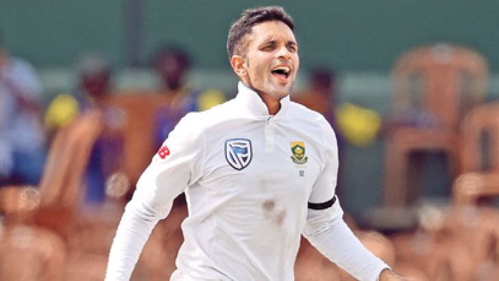 South African spinner Keshav Maharaj celebrates the dismissal of Sri Lanka's Angelo Mathews on the first day of the second Test at the SSC grounds yesterday. – AFP