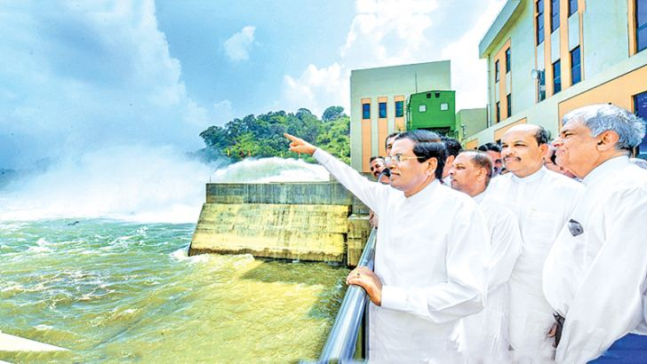 President Maithripala Sirisena and Prime Minister Ranil Wickremesinghe at the Moragahakanda Reservoir after the President  commissioned one of the the last reservoirs of the Mahaweli River Development Programme in January. Picture courtesy President's Media Division