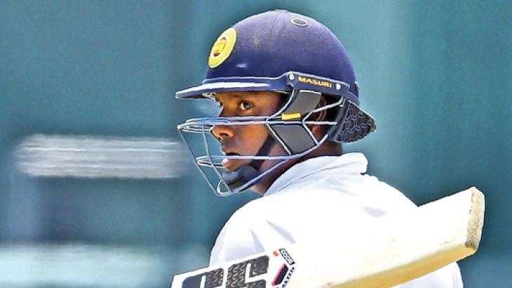 Sri Lanka's Angelo Mathews acknowledges his half-century on the third day of the second Test match against South Africa at the SSC grounds yesterday. AFP