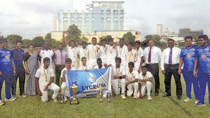 Lyceum International School Nugegoda Inter-International Schools under 19 cricket champions 2018.   Standing (From left) Chamara Guruge (coach) Dishan Saminda (Coach) Mrs. Dulka Mendis (Principal) Lal Senarathne (Head Coach), Sameera Hewage (Head of Sports), Pasindu rajapakshe, chalindu Sasimal, Vihanga Abeypitiya captain), Ravindu Rajarathne, Dimuth Keshan, Nipuna Hettirachchi, Sadushka Senaratn, Kasun Dissanayake (headmaster), Dayan Fernando (warden), Viraj Ranasinghe (Coach), Kasun Sank (Coach).  Squatti