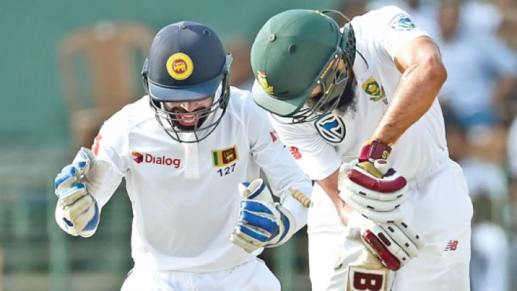 South African batsman Hashim Amla has his off stump sent cartwheeling by a Rangana Herath special on the third day of the second Test at the SSC grounds yesterday. - AFP