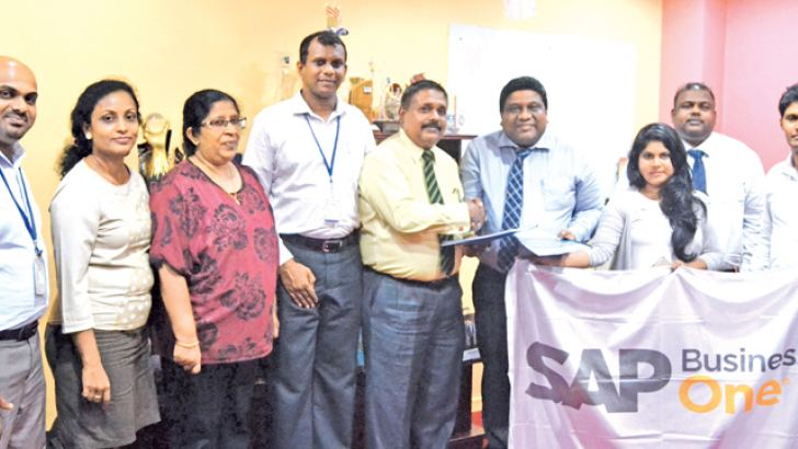Perfect Business Solutions Services and SLT RAINBOW PAGES officials exchanging the MoU in Colombo recently.