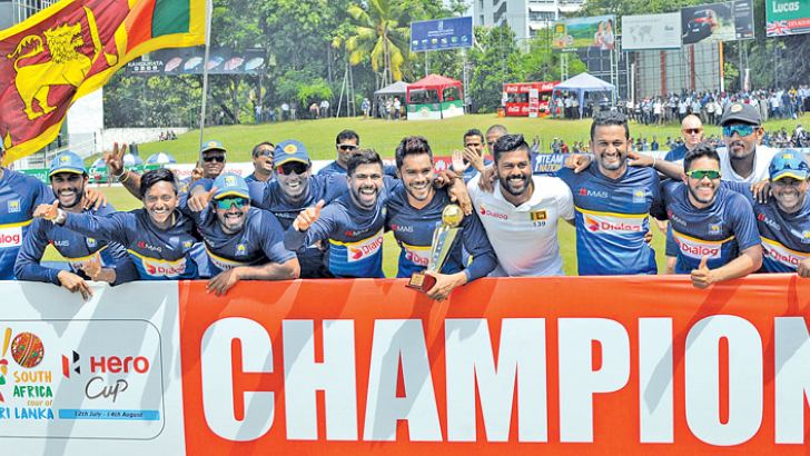 The victorious Sri Lanka team celebrate their 2-0 series whitewash against South Africa at the SSC grounds yesterday. (Pix by Susantha Wijegunasekera)